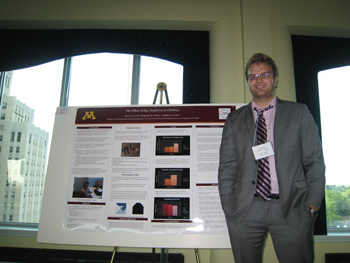 A graduate student with a poster