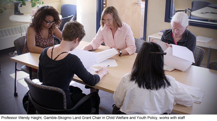 Professor Wendy Haight, Gamble-Skogmo Land Grant Chair in Child Welfare and Youth Policy, works with staff